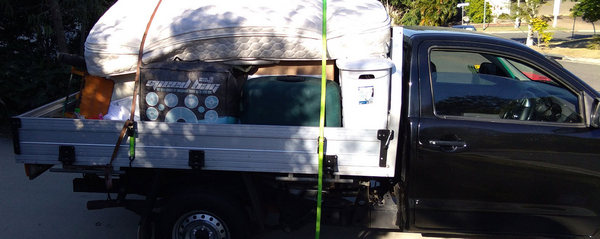 North Brisbane movers and rubbish removal services loaded ute photo blue
