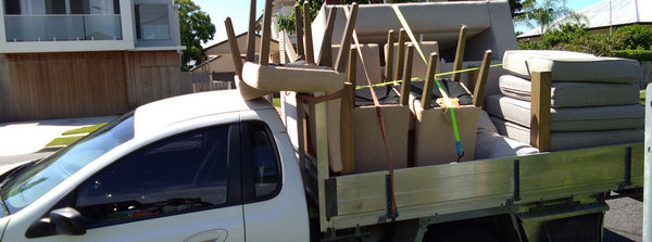 North Brisbane movers and rubbish removal services loaded ute photo white